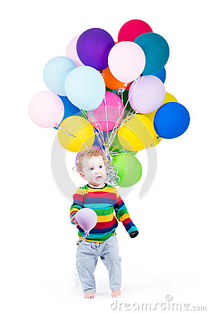 Funny baby playing with colorful balloons
