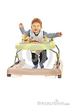 Funny baby running in walker