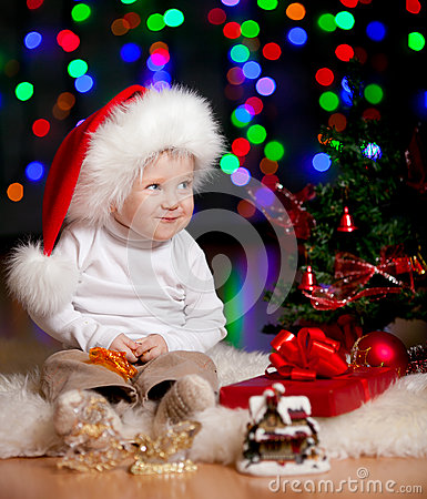 Funny baby Santa Claus on bright background