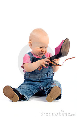 Funny baby with shoe