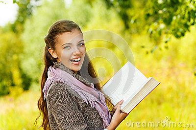 Funny beautiful woman reading book