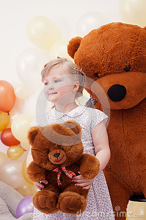 Funny blonde girl posing with teddy bears