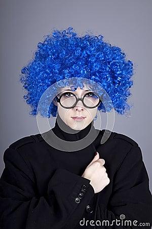 Funny blue-hair girl in glasses and black coat.