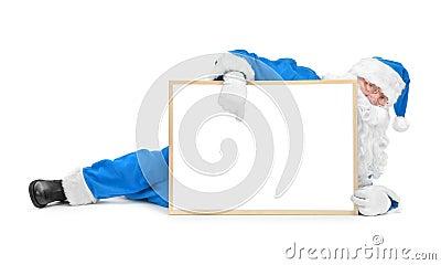 Funny blue santa and empty white board