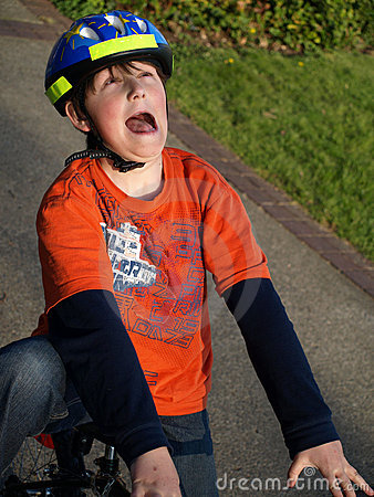 Funny boy on the bike with helmet
