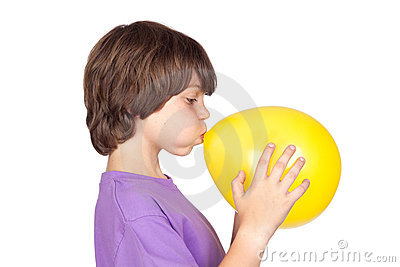 Funny boy blowing up a yellow balloon