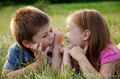 Funny Boy and girl on grass