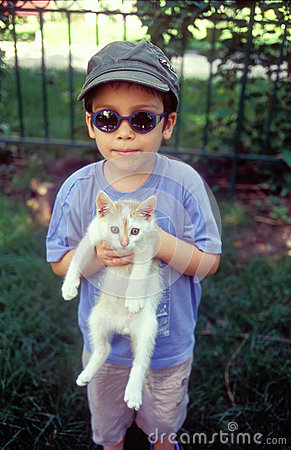 Boy holding cat