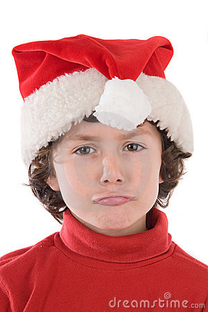 Funny boy with red hat of Christmas pulling a face