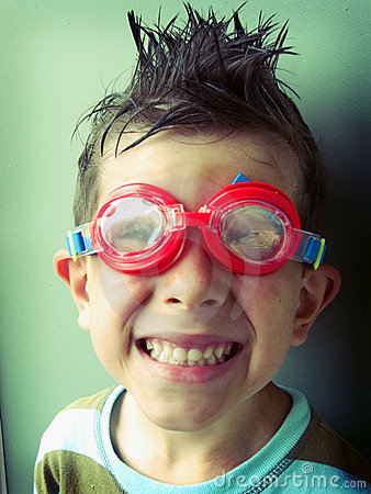 Funny boy smiling in swimming googles