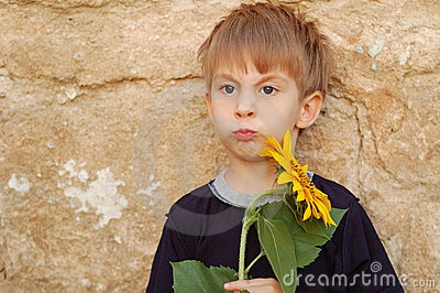 Funny boy with sunflower