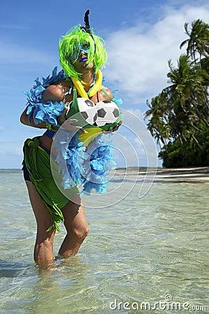 ... Brazilian soccer fan fondling her soccer balls on tropical beach