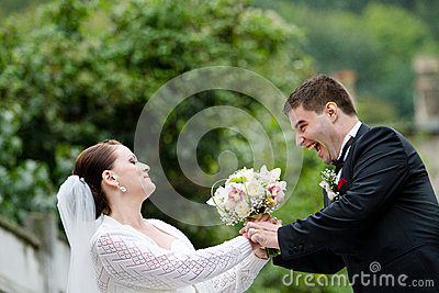 Funny Bride and Groom with Wedding Bouquet
