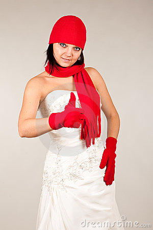 Funny bride with red hat and scarf