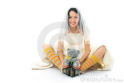 Funny bride wearing sporting shoes with a toy