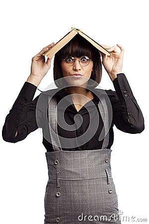 Funny brunette schoolgirl hiding under the roof