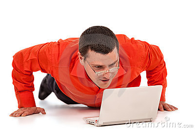 Funny businessman doing push-ups