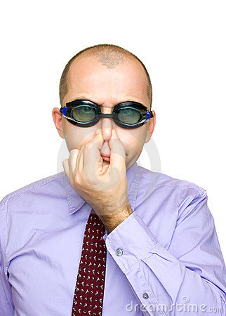 Funny businessman with swimming goggles