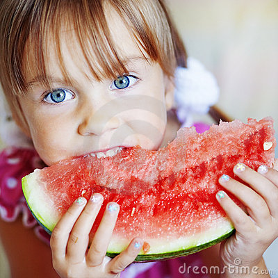 Funny child eating watermelon