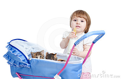 Funny child feeding attractive kitten from bottle