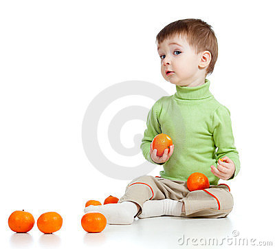 Funny child with fruits over white