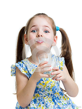 Funny child girl drinking yogurt or kefir