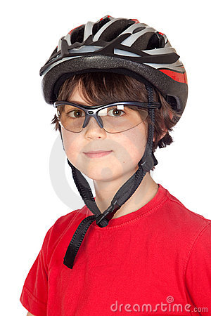 Funny child with glasses and a bicycle helmet