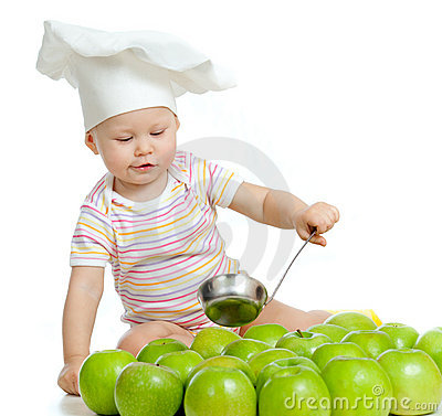 Funny child with green apples healthy food