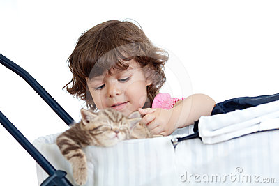 Funny child playing with attractive kitten