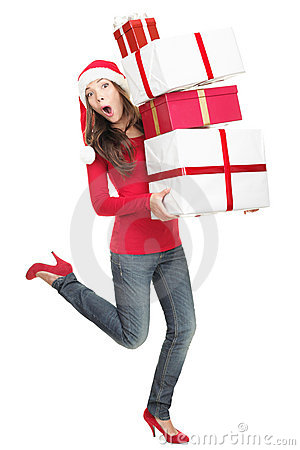 Funny christmas woman in hurry running with gifts