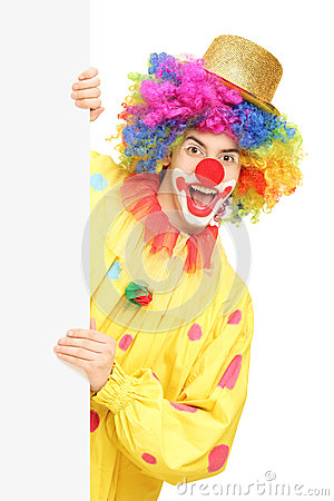 Funny circus clown holding a blank panel