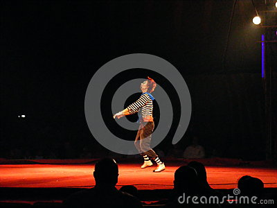 Funny clown artist dancing at circus Editorial Photography
