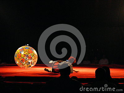 Funny clown artist performing at circus Editorial Image