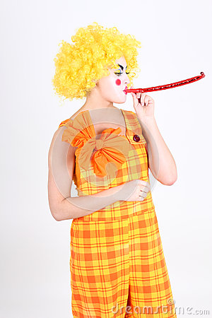 Funny clown in costume with whistle