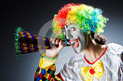 Funny clown in studio