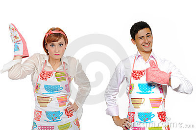 Funny cooking couple-man in apron and chef woman
