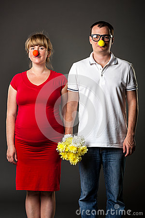 Funny couple with funny noses and bunch of flowers