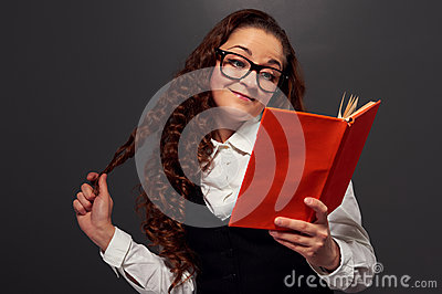 Funny curly woman reading a novel