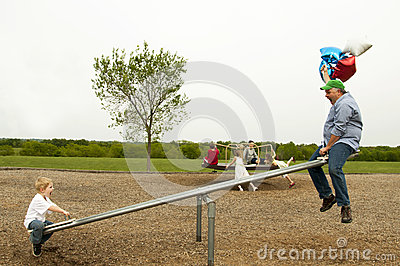 Funny dad on teeter-totter