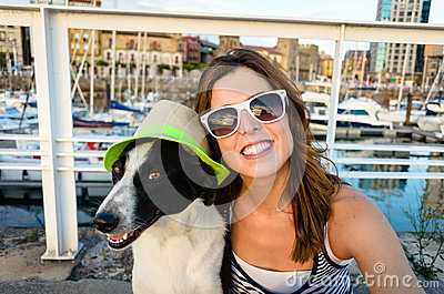 Funny dog and woman on summer vacation travel