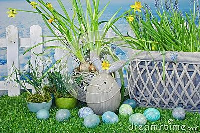 Funny easter bunny in garden