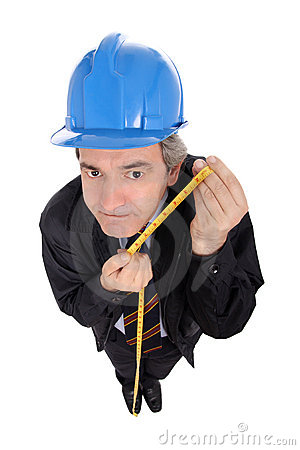 Funny engineer with a measuring tape