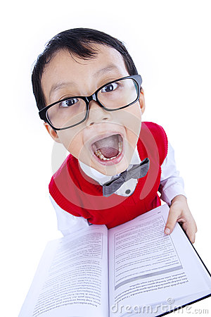 Funny expression of nerd boy holding book - isolated