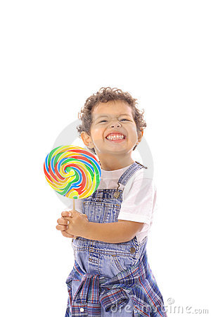 Funny face toddler with big lollipop