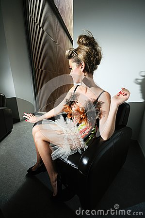 Funny girl in armchair