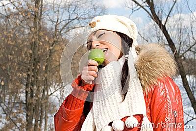Funny girl eating apple