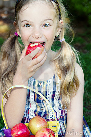 Funny girl eating apple