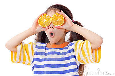 Funny girl with fruits on eyes