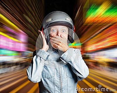 Funny girl in helmet moving on the street
