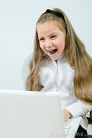 Funny girl with laptop indoors
